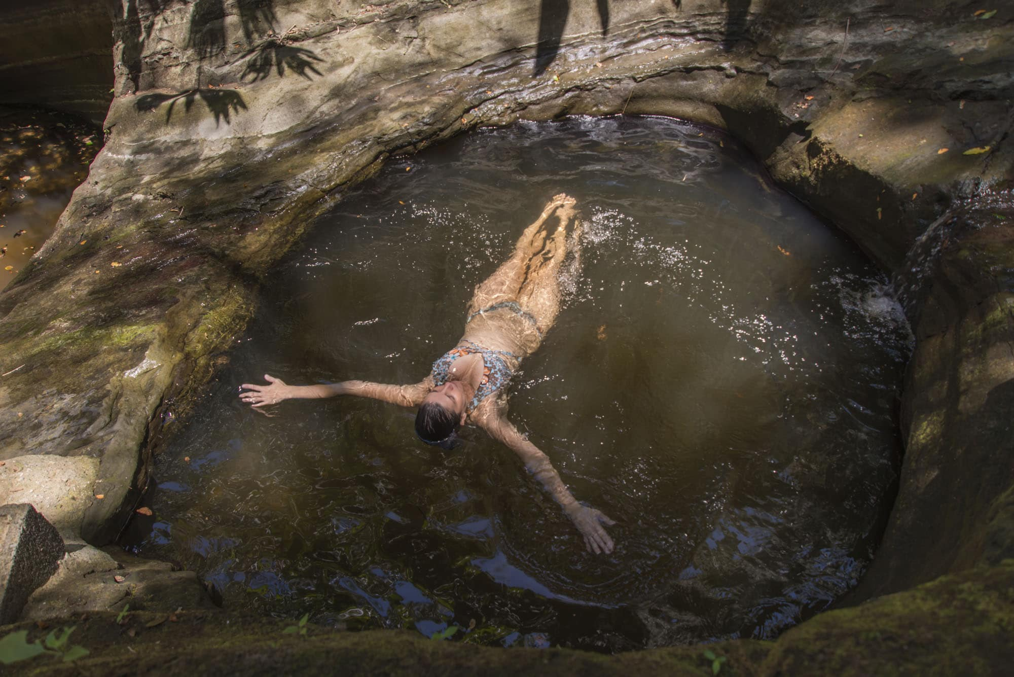 floating in a natural pool